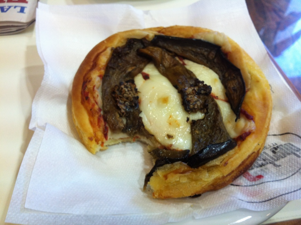 Pizzetta, a miniature-sized 'pizza' of puff pastry, tomato sauce, Fontina and grilled aubergine. Highly addictive. You have been warned.